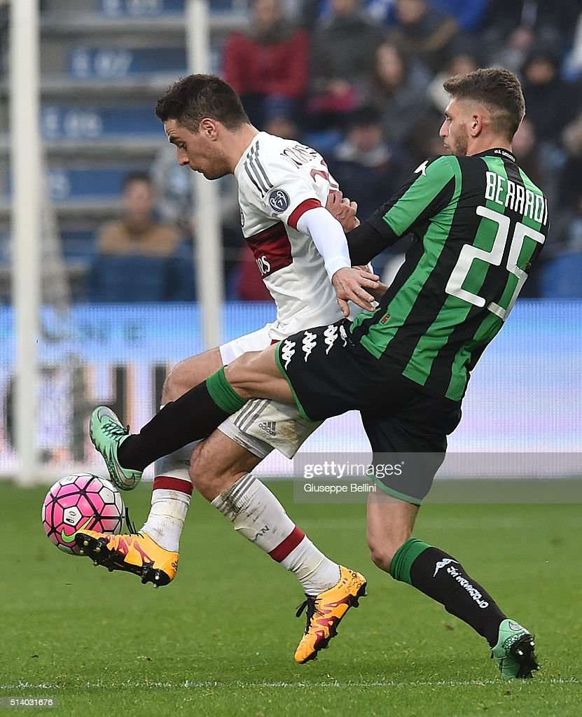 Giacomo Bonaventura of AC Milan and Domenico Berardi of US Sassuolo Calcio in action during the Serie A match between US Sassuolo Calcio and AC Milan at Mapei Stadium - Città del Tricolore on March 6, 2016 in Reggio nell'Emilia, Italy.
