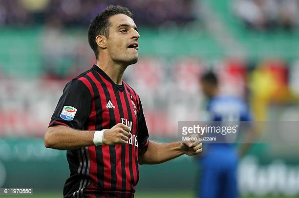 Giacomo Bonaventura of AC Milan celebrates after scoring the opening goal during the Serie A match between AC Milan and US Sassuolo at Stadio...
