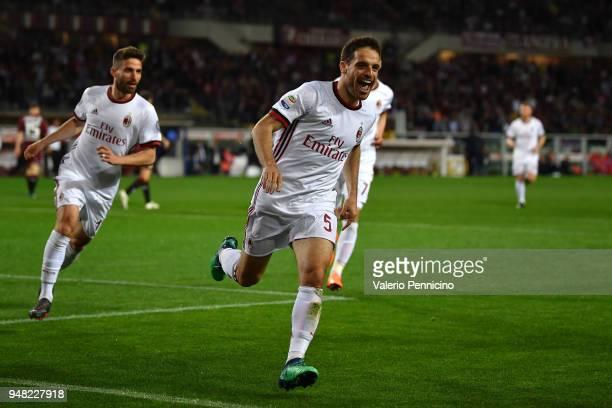 Giacomo Bonaventura of AC Milan celebrates after scoring the opening goal during the Serie A match between Torino FC and AC Milan at Stadio Olimpico...