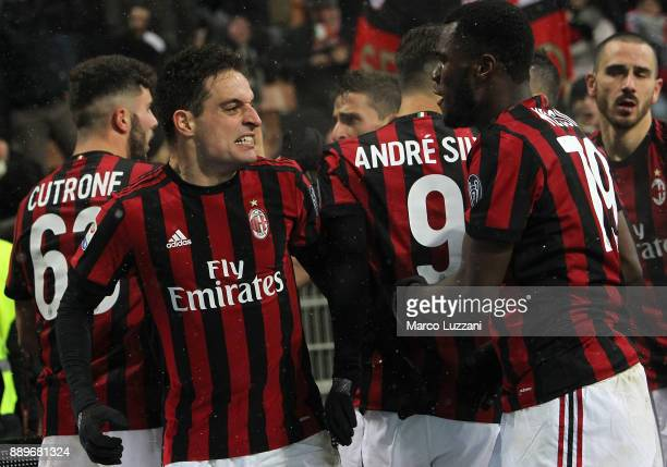 Giacomo Bonaventura of AC Milan celebrates his second goal with his teammate Franck Kessie during the Serie A match between AC Milan and Bologna FC...