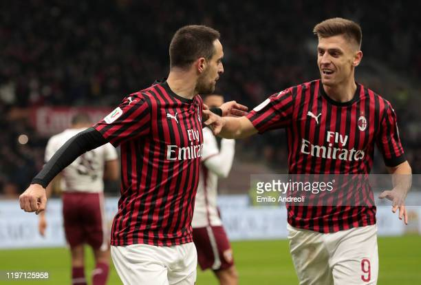 Giacomo Bonaventura of AC Milan celebrates with his teammate Krzysztof Piatek after scoring the opening goal during the Coppa Italia Quarter Final...