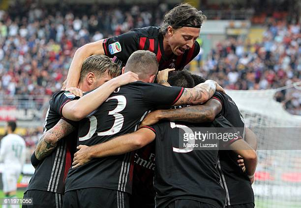 Giacomo Bonaventura of AC Milan celebrates with his teammates after scoring the opening goal during the Serie A match between AC Milan and US...