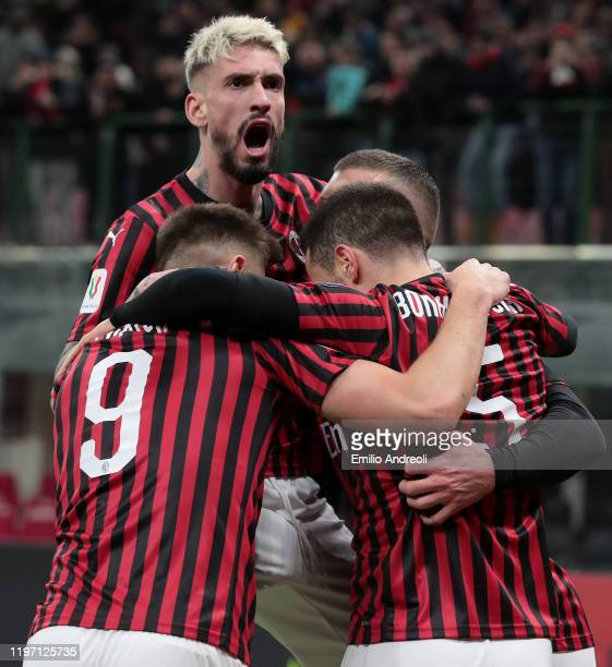 Giacomo Bonaventura of AC Milan celebrates with his teammates Krzysztof Piatek and Samuel Castillejo after scoring the opening goal during the Coppa...