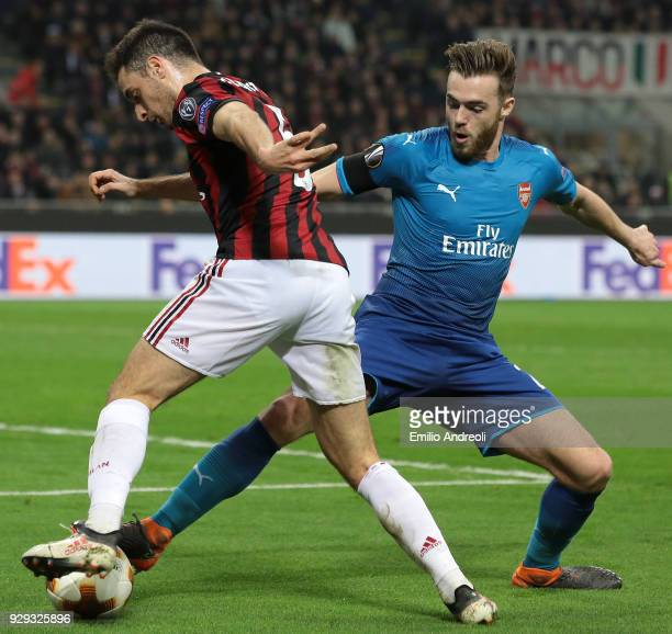 Giacomo Bonaventura of AC Milan competes for the ball with Calum Chambers of Arsenal during UEFA Europa League Round of 16 match between AC Milan and...