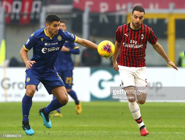 Giacomo Bonaventura of AC Milan competes for the ball with Davide Faraoni of Hellas Verona during the Serie A match between AC Milan and Hellas...