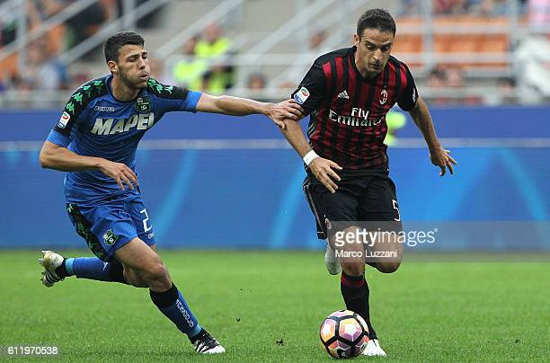 Giacomo Bonaventura of AC Milan competes for the ball with Luca Mazzitelli of US Sassuolo during the Serie A match between AC Milan and US Sassuolo...