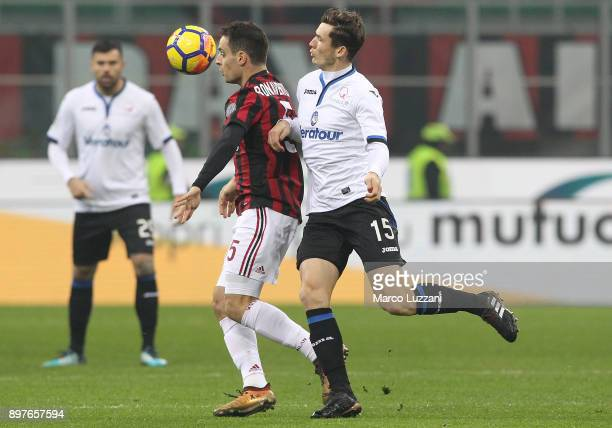 Giacomo Bonaventura of AC Milan competes for the ball with Marten De Roon of Atalanta BC during the serie A match between AC Milan and Atalanta BC at...