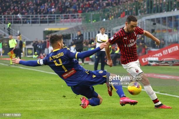Giacomo Bonaventura of AC Milan competes for the ball with Miguel Veloso of Hellas Verona during the Serie A match between AC Milan and Hellas Verona...