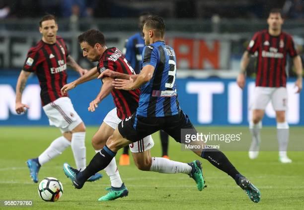 Giacomo Bonaventura of AC Milan competes for the ball with Rafael Toloi of Atalanta BC during the serie A match between Atalanta BC and AC Milan at...