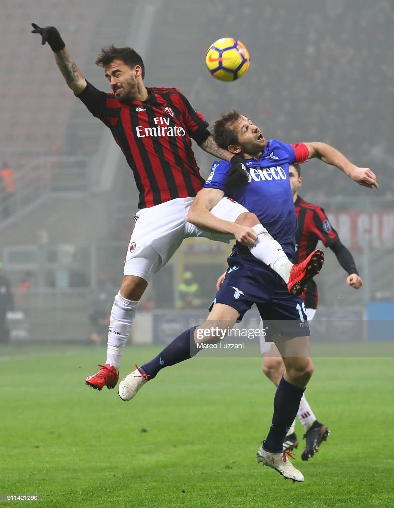 Giacomo Bonaventura of AC Milan competes for the ball with Senad Lulic of SS Lazio during the serie A match between AC Milan and SS Lazio at Stadio Giuseppe Meazza on January 28, 2018 in Milan, Italy.