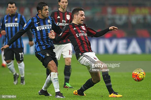 Giacomo Bonaventura of AC Milan is challenged by Eder Citadin Martins of FC Internazionale Milano during the Serie A match between AC Milan and FC...