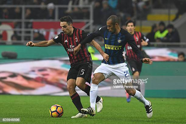 Giacomo Bonaventura of AC Milan is challenged by Joao Miranda of FC Internazionale during the Serie A match between AC Milan and FC Internazionale at...