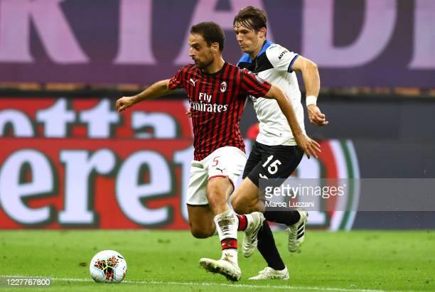 Giacomo Bonaventura of AC Milan is challenged by Marten De Roon of Atalanta BC during the Serie A match between AC Milan and Atalanta BC at Stadio...