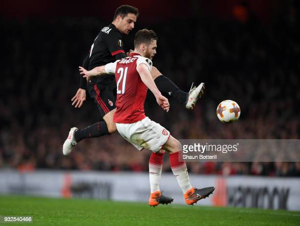 Giacomo Bonaventura of AC Milan tackles Calum Chambers of Arsenal during the UEFA Europa League Round of 16 Second Leg match between Arsenal and AC...