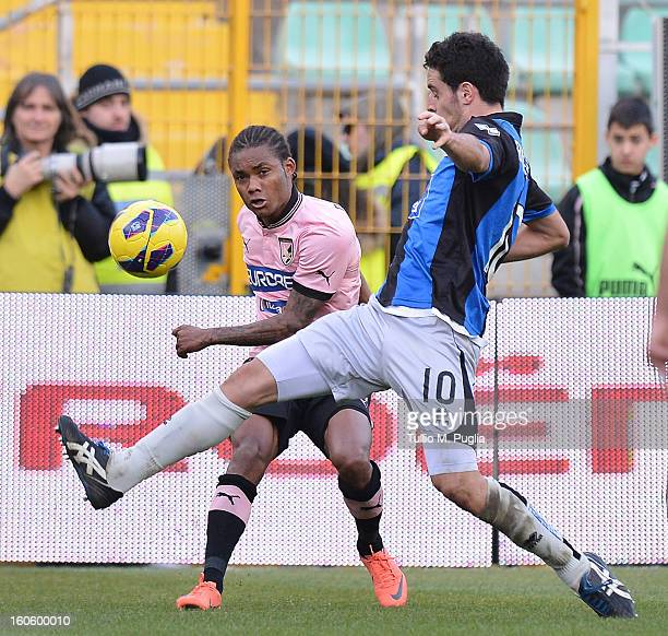 Giacomo Bonaventura of Atalanta and Augusto Nelson of Palermo compete for the ball during the Serie A match between US Citta di Palermo and Atalanta...