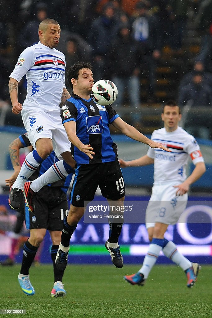 Giacomo Bonaventura (R) of Atalanta BC shields the ball from Angelo Palombo of UC Sampdoria during the Serie A match between Atalanta BC and UC Sampdoria at Stadio Atleti Azzurri d'Italia on March 30, 2013 in Bergamo, Italy.