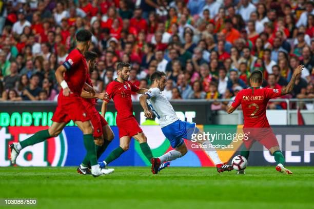 Giacomo Bonaventura of Italy and AC Milan tries to escape Portuguese players during the UEFA Nations League A group three match between Portugal and...