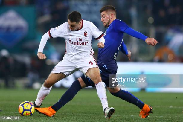 Giacomo Bonaventura of Milan and Sergej MilinkovicSavic of Lazio during the TIM Cup match between SS Lazio and AC Milan at Olimpico Stadium on...