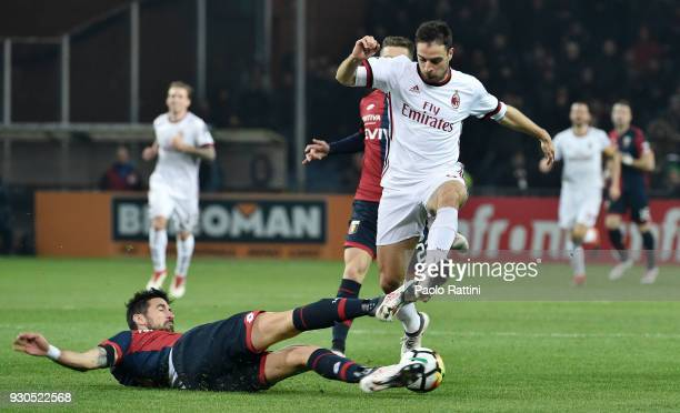 Giacomo Bonaventura of Milan is tackled by Nicolas Spolli of Genoa during the serie A match between Genoa CFC and AC Milan at Stadio Luigi Ferraris...