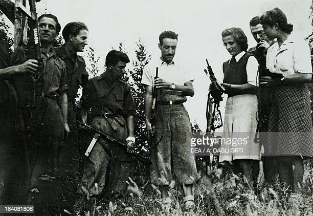 Giacomo Chilesotti Commander Neptune in the centre with young men and women partisans Berici Hills April 1945 World War II Resistance Italy 20th...