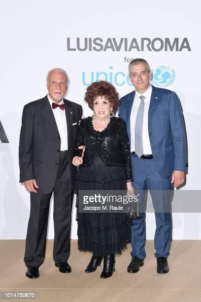 Giacomo Guerrera Gina Lollobrigida and Paolo Rozera attend a photocall for the Unicef Summer Gala Presented by Luisaviaroma at Villa Violina on...