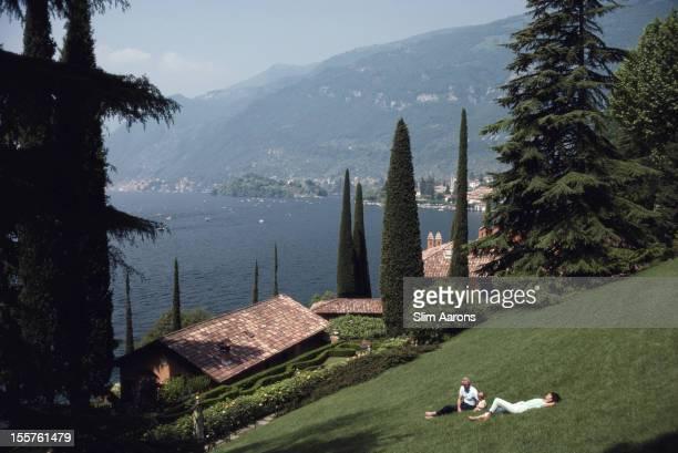 Giacomo Montegazza and Stefania Montegazza laying in the grounds of their villa, La Cassinella, on Lake Como, Italy, in June 1983.