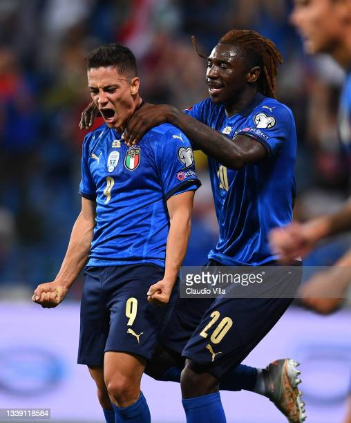 Giacomo Raspadori of Italy celebrate with Moise Kean after scoring the goal during the 2022 FIFA World Cup Qualifier match between Italy and...