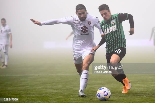 Giacomo Raspadori of US Sassuolo is challenged by Ricardo Rodriguez of Torino FC during the Serie A football match between US Sassuolo and Torino FC...
