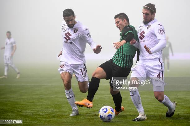 Giacomo Raspadori of US Sassuolo is challenged by Ricardo Rodriguez and Lyanco Evangelista Silveira Neves Vojnovic of Torino FC during the Serie A...