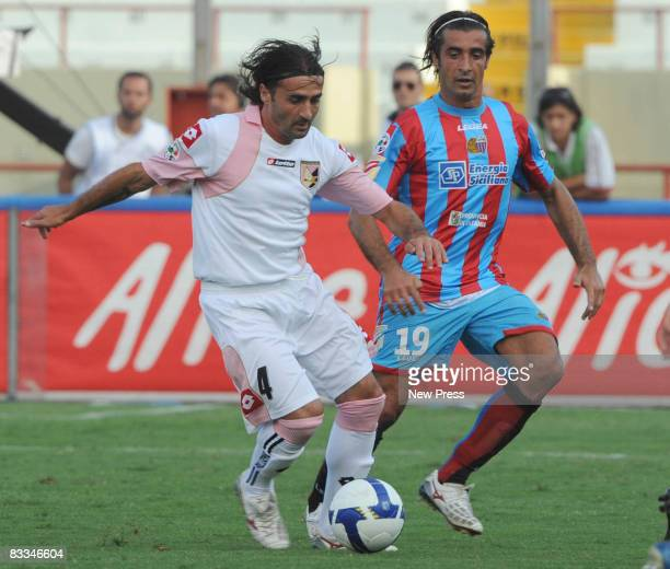 Giacomo Tedesco of Catania and his brother Giovanni Tedesco of Palermo in action during the Serie A match between Catania and Palermo at the Stadio...
