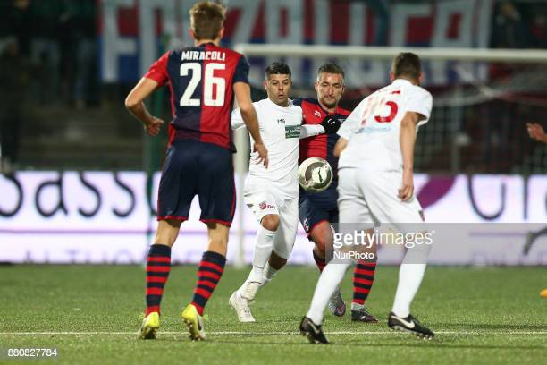 Giacomo Tulli of Teramo Calcio 1913 compete for the ball with Armin Bacinovic of SS Sambenedettese during the Lega Pro 17/18 group B match between...