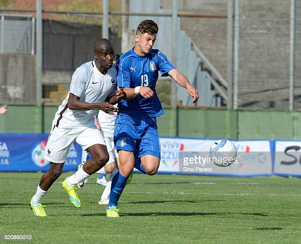 Giacomo Vrioni of Italy competes with Peter Ouaneh of France during the U18 international friendly match between Italy and France at Stadio Appiani...