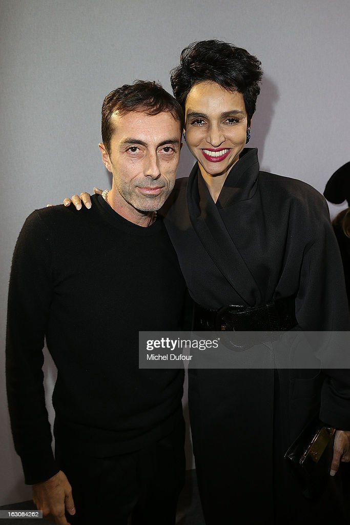 Giambattista Valli (L) and Farida Khelfa pose together backstage at the Giambattista Valli Fall/Winter 2013 Ready-to-Wear show as part of Paris Fashion Week on March 4, 2013 in Paris, France.