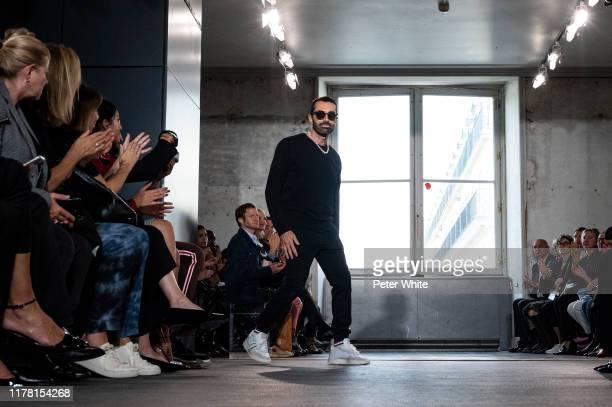 Giambattista Valli walks the runway at the end of the Giambattista Valli Womenswear Spring/Summer 2020 show as part of Paris Fashion Week on...