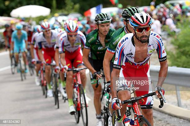 Giampaolo Caruso of Italy riding for Team Katusha rides at the front of the peloton as they pursue the breakaway on the Col de l'Escrinet during...