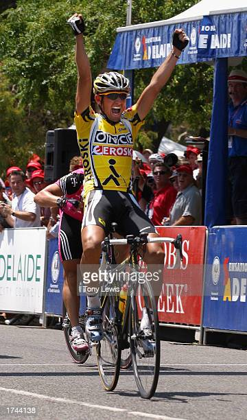 Giampaolo Caruso of the ONCEEroski team salutes the crowd as he crosses the finish line to win stage five of the Tour Down Under cycle race held near...