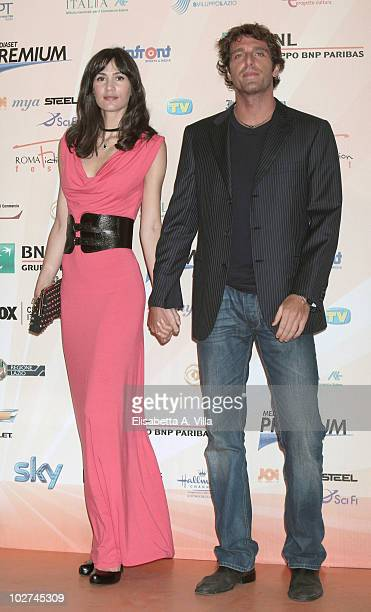 Giampaolo Morelli and fiancee Gloria Bellicchi attend a photocall for L'Ispettore Coliandro 4 during the Roma Fiction Fest at Adriano Cinema on July...