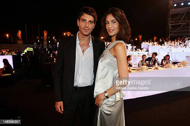 Giampaolo Morelli and Gloria Bellicchi attend the OCTO The New Architecture of Time by Bulgari dinner at the Stadio dei Marmi on July 13 2012 in Rome...