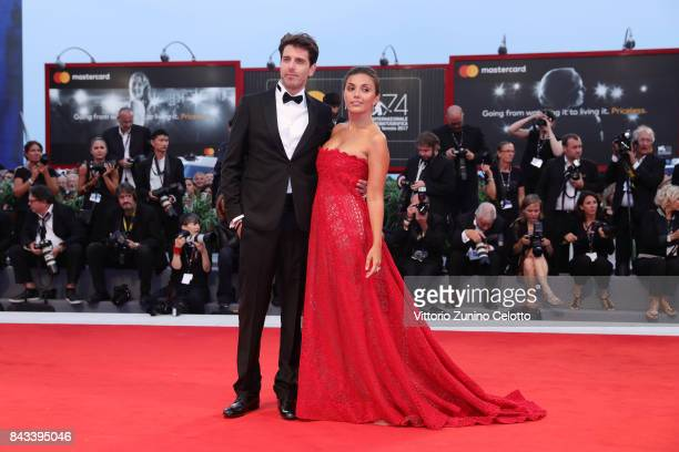 Giampaolo Morelli and Serena Rossi walk the red carpet ahead of the 'Ammore E Malavita' screening during the 74th Venice Film Festival at Sala Grande...