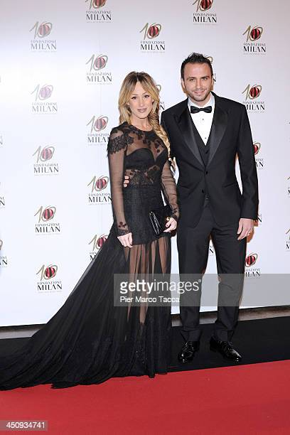 Giampaolo Pazzini and Silvia Slitti attend the Fondazione Milan 10th Anniversary Gala photocall on November 20 2013 in Milan Italy