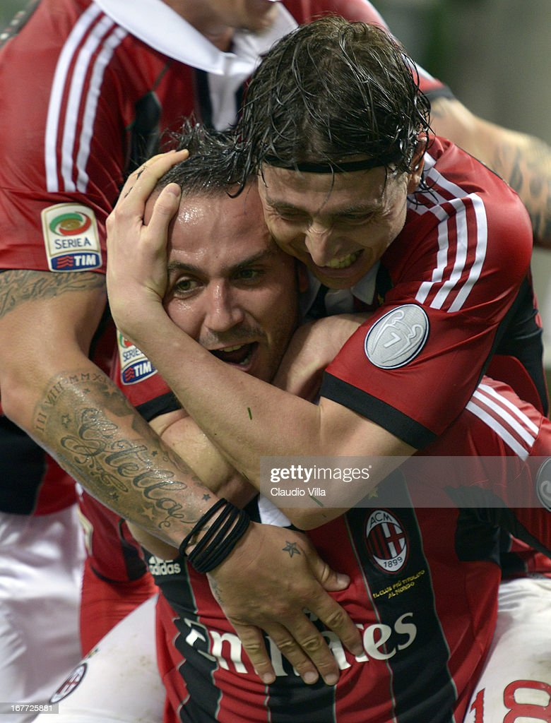 Giampaolo Pazzini of AC Milan celebrates scoring the third goal with team-mate Riccardo Montolivo (R) during the Serie A match between AC Milan and Calcio Catania at San Siro Stadium on April 28, 2013 in Milan, Italy.