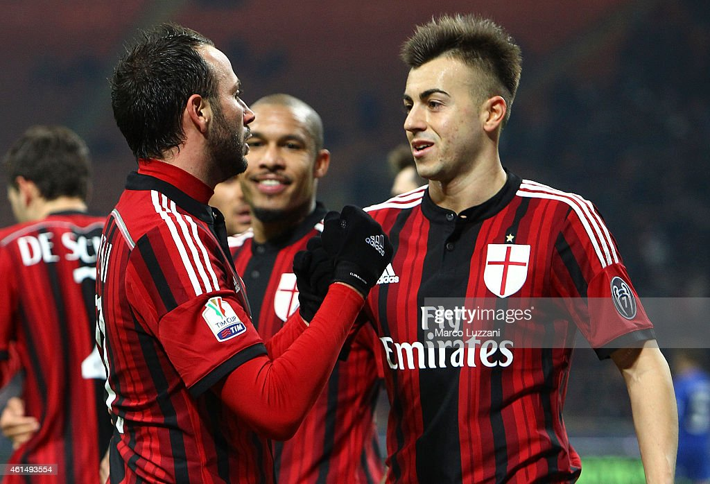 Giampaolo Pazzini (L) of AC Milan celebrates with his team-mate Stephan El Shaarawy (R) after scoring the opening goal during the TIM Cup match between AC Milan and US Sassuolo Calcio at Stadio Giuseppe Meazza on January 13, 2015 in Milan, Italy.