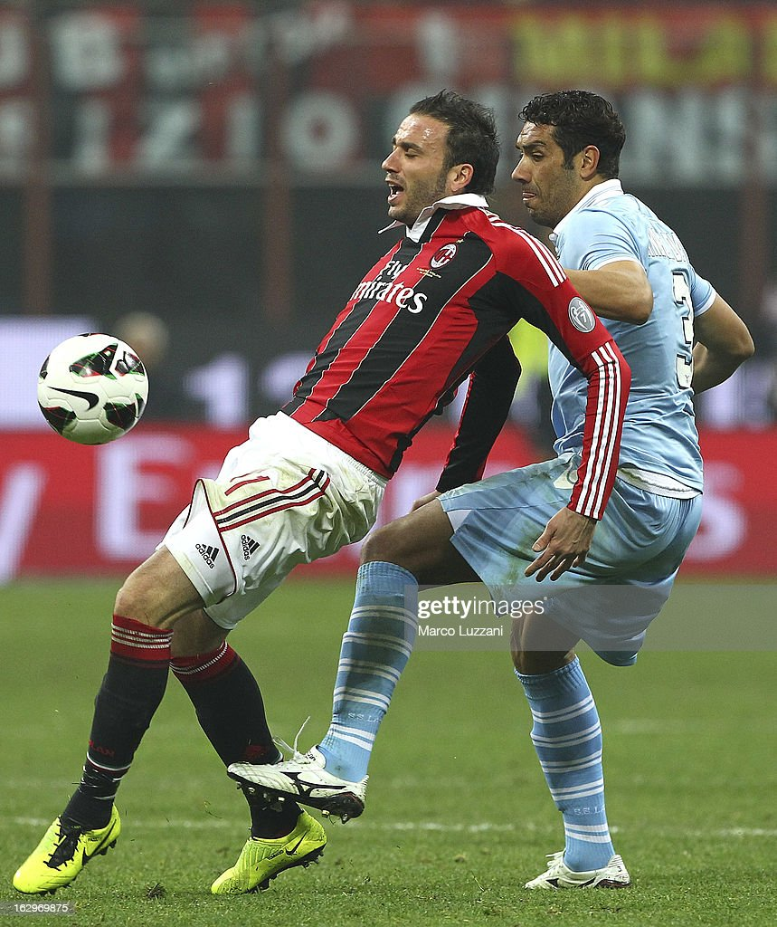 Giampaolo Pazzini of AC Milan competes for the ball with Andre' Goncalves Dias of S.S. Lazio during the Serie A match between AC Milan and S.S. Lazio at San Siro Stadium on March 2, 2013 in Milan, Italy.