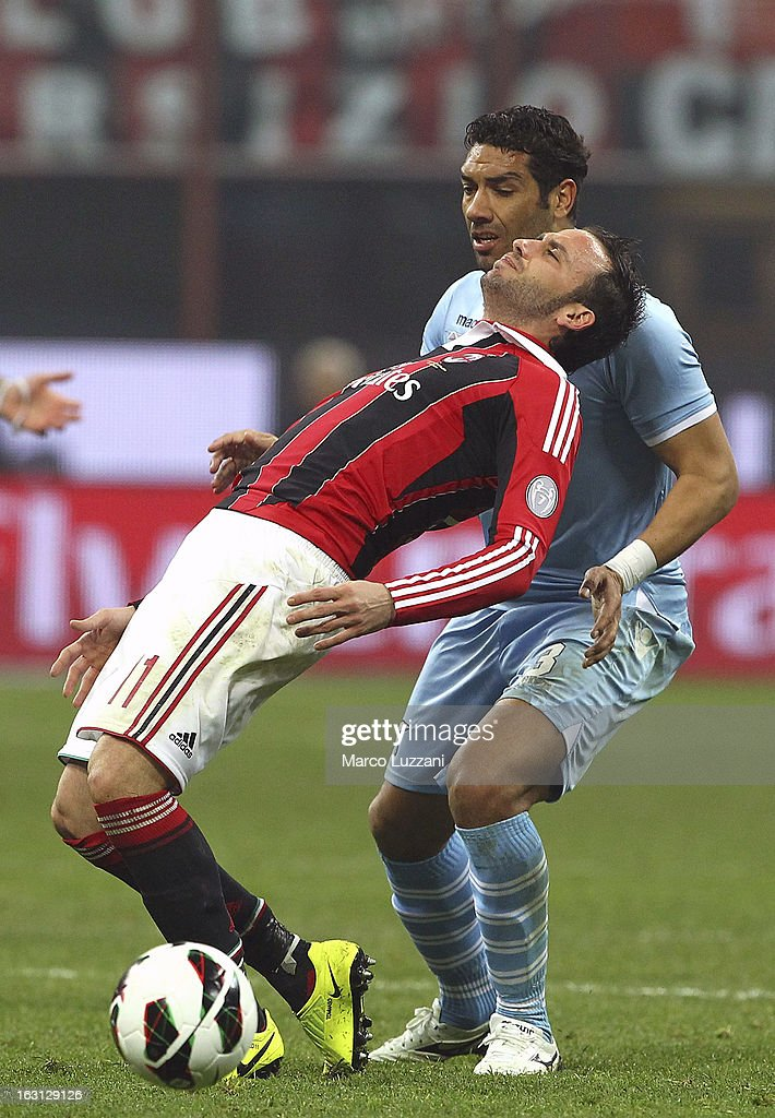 Giampaolo Pazzini of AC Milan competes for the ball with Andre Goncalves Dias of S.S. Lazio during the Serie A match between AC Milan and S.S. Lazio at San Siro Stadium on March 2, 2013 in Milan, Italy.