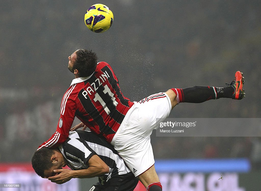 Giampaolo Pazzini of AC Milan competes for the ball with Leonardo Bonucci of Juventus FC during the Serie A match between AC Milan and Juventus FC at San Siro Stadium on November 25, 2012 in Milan, Italy.