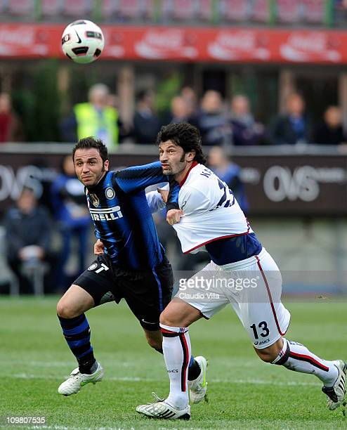 Giampaolo Pazzini of FC Inter Milan and Kakha Kaladze of Genoa CFC compete for the ball during the Serie A match between FC Internazionale Milano and...