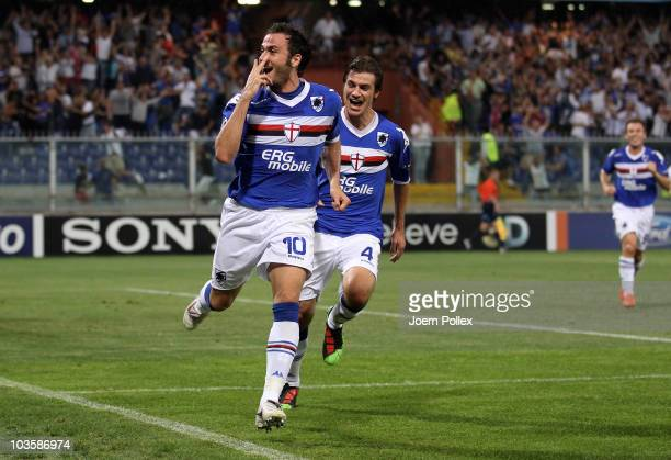 Giampaolo Pazzini of Genua celebrates with his team mate Daniele Dessena after scoring his second goal during the Uefa Champions League qualifying...