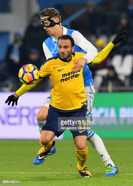 Giampaolo Pazzini of Hellas Verona competes for the ball whit Bartosz Salamon of Spal during the Serie A match between Spal and Hellas Verona FC at...