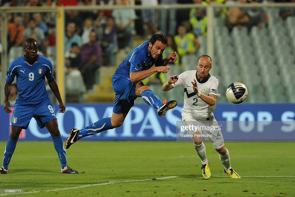 Giampaolo Pazzini (C) of Italy scores a opening goal during the UEFA EURO 2012 Group C qualifying match between Italy and Slovenia at Stadio Artemio Franchi on September 6, 2011 in Florence, Italy.