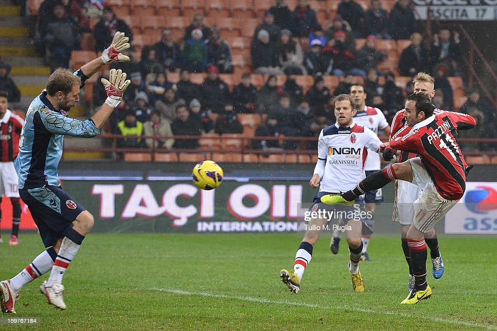 Giampaolo Pazzini (R) of Milan scores his team's second goal during the Serie A match between AC Milan and Bologna FC at San Siro Stadium on January 20, 2013 in Milan, Italy.